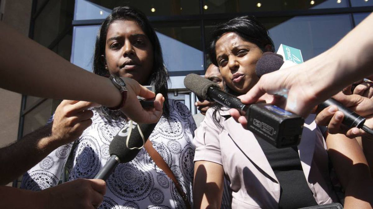 Darshika Selvasivam (left) with the Tamil Refugee coordinating committee and Katpana Nagendra (right) with the BC Canada representative of the Transnational Government of Tamil Eelam outside the immigration and refugee board in Vancouver August 17, 2010 after the IRB made a ruling on the publication ban.