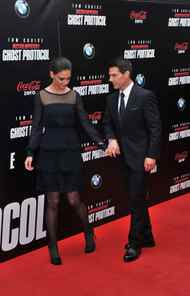 "After touring the world to promote ""Mission: Impossible - Ghost Protocol"", Tom Cruise finally premiered his movie in New York on Monday, where he got his wife Katie Holmes out of cryo-lock for the evening and carefully manoeuvred her into place on the red carpet."
