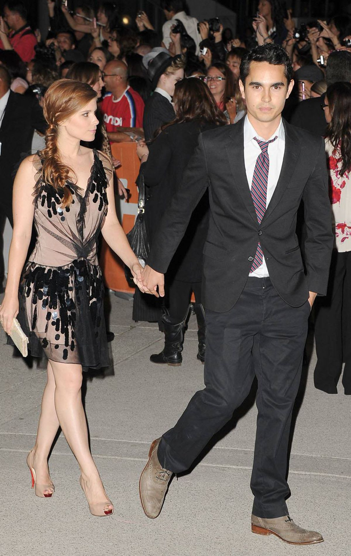 "TORONTO, ON - SEPTEMBER 09: Actress Kate Mara (L) and Actor Max Minghella arrive at ""Ides Of March"" Premiere at Roy Thomson Hall during the 2011 Toronto International Film Festival on September 9, 2011 in Toronto, Canada. (Photo by Jason Merritt/Getty Images)"