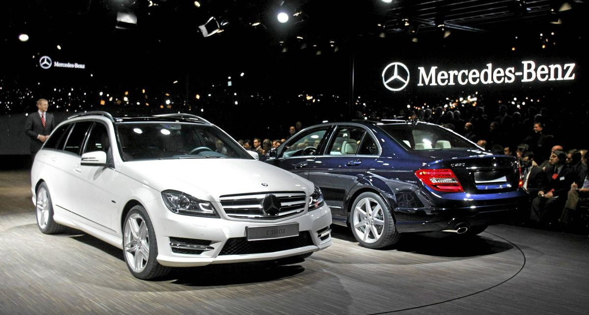 Two new Mercedes-Benz C-Class vehicles are shown at a Mercedes Benz event the night before the official start of the 2011 North American International Auto Show January 9, 2011 in Detroit.
