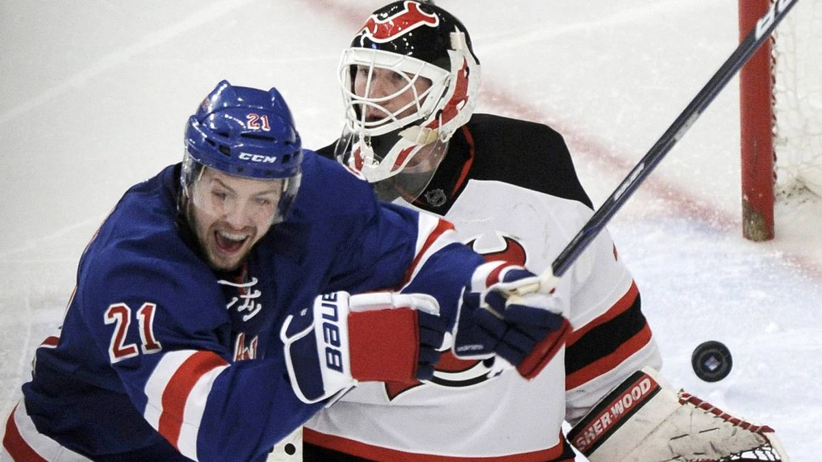 New York Rangers' Derek Stepan celebrates in front of New Jersey Devils goaltender Martin Brodeur after the puck entered the net on a goal by Rangers' Dan Girardi (not shown) during the third period of Game 1 of the NHL Eastern Conference Finals hockey playoffs at Madison Square Garden in New York, May 14, 2012. REUTERS/Ray Stubblebine