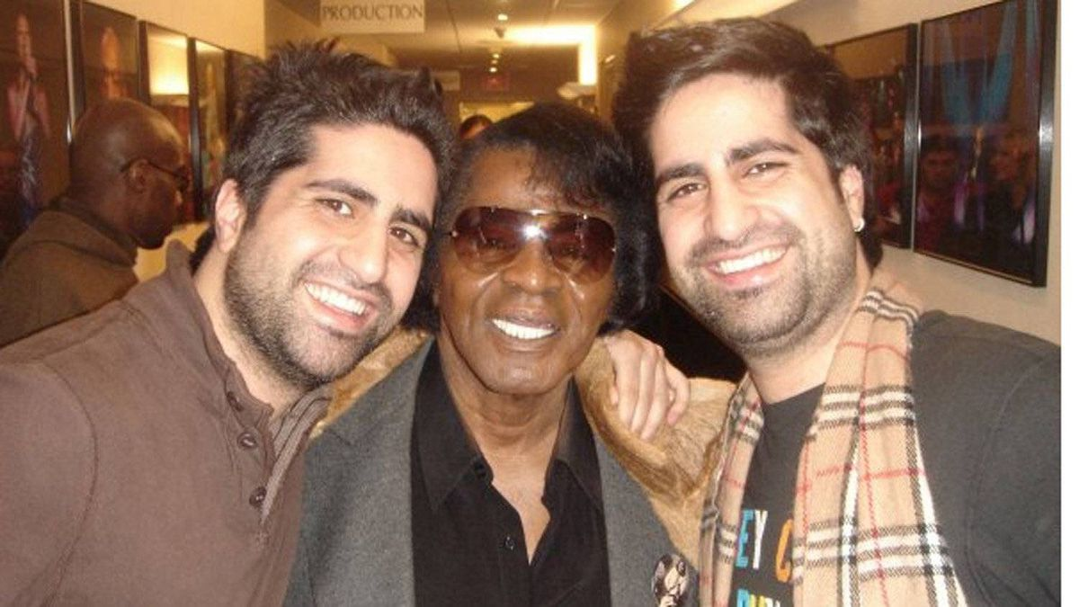Twin brothers Page, left, and Jian Magen, co-owners of Magen Boys Entertainment, with singer James Brown