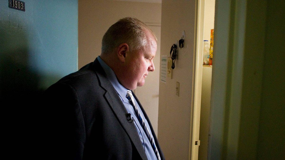 Toronto's Mayor Rob Ford inspects a resident's apartment during a tour of a Toronto community housing building in the city's east end on Feb. 16, 2012