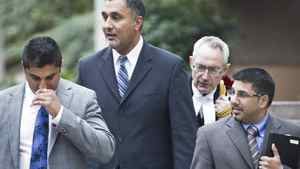 Aneal Basi (L), Dave Basi (centre left), his Lawyer Michael Bolton (centre right) and Bob Virk (R) leave BC Supreme Court October 18, 2010. Dave Basi and Bob Virk agreed to change their pleas while charges against a third person, Aneal Basi, cousin of Dave, were dropped altogether in the BC legislature raid trial.