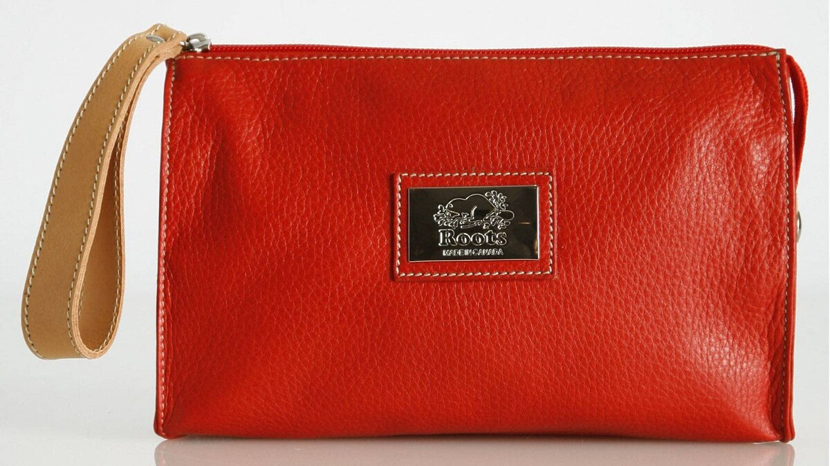 Carry it Tired of lugging around an oversized handbag on city walks? With its bold cherry-red exterior, handy wrist zipper pull and satin hot-pink lining, Roots's Large Monika Clutch is a sassy way to travel lightly while keeping your valuables close at hand. It's made from 100-per-cent Italian pebbled leather that is specially sealed and treated, which means it can weather an unexpected downpour without needing a pre-emptive protective spray. $88. canada.roots.com