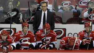 Carolina Hurricanes coach Paul Maurice, rear, and players watch from the bench during the closing moments of an NHL hockey game against the Tampa Bay Lightning in Raleigh, N.C., Saturday, April 9, 2011. Tampa Bay won 6-2. (AP Photo/Gerry Broome)