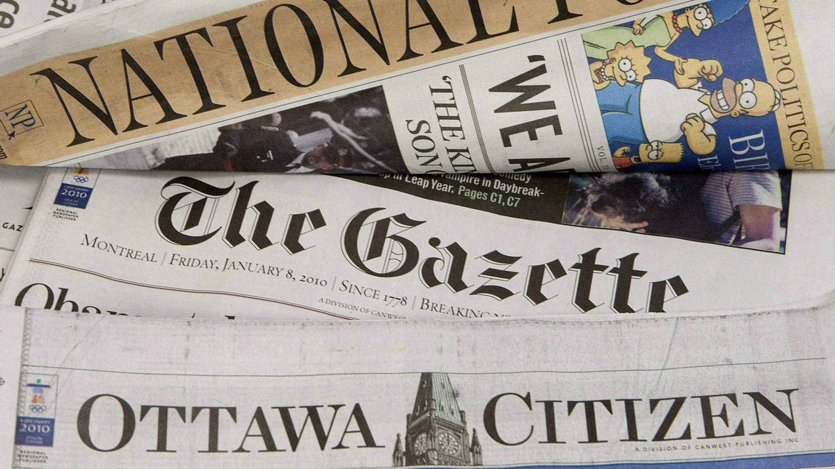 Some of Postmedia's newspapers are displayed in Ottawa on January 8, 2010.