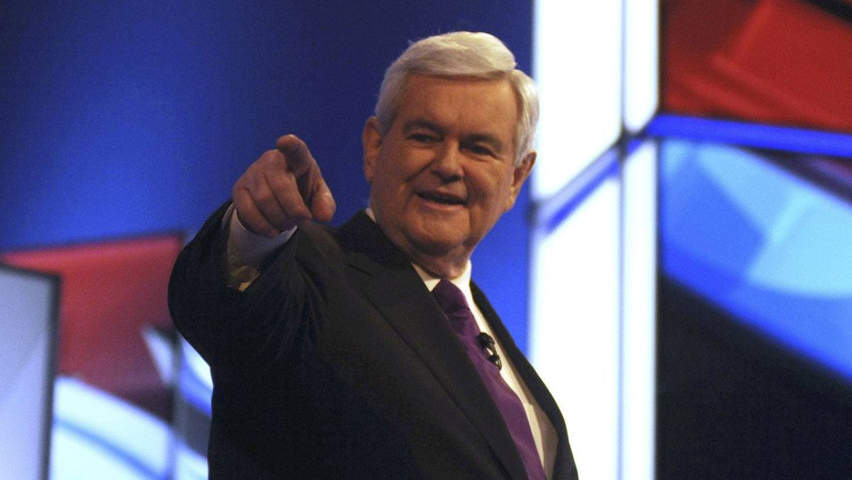 Newt Gingrich greets the crowd before the debate.