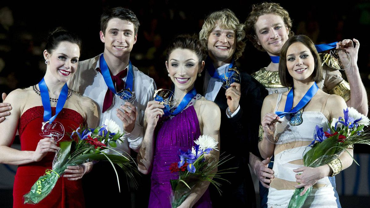 Ice dance gold medalists Meryl Davis and Charlie White, centre, of the USA, silver medalists Tessa Virtue and Scott Moir, left, of Canada, and bronze medalists Nathalie Pechalat and Fabian Bourzat of France hold up their medals during victory ceremonies at the ISU Grand Prix of Figure Skating Final Sunday, December 11, 2011 in Quebec City. THE CANADIAN PRESS/Paul Chiasson