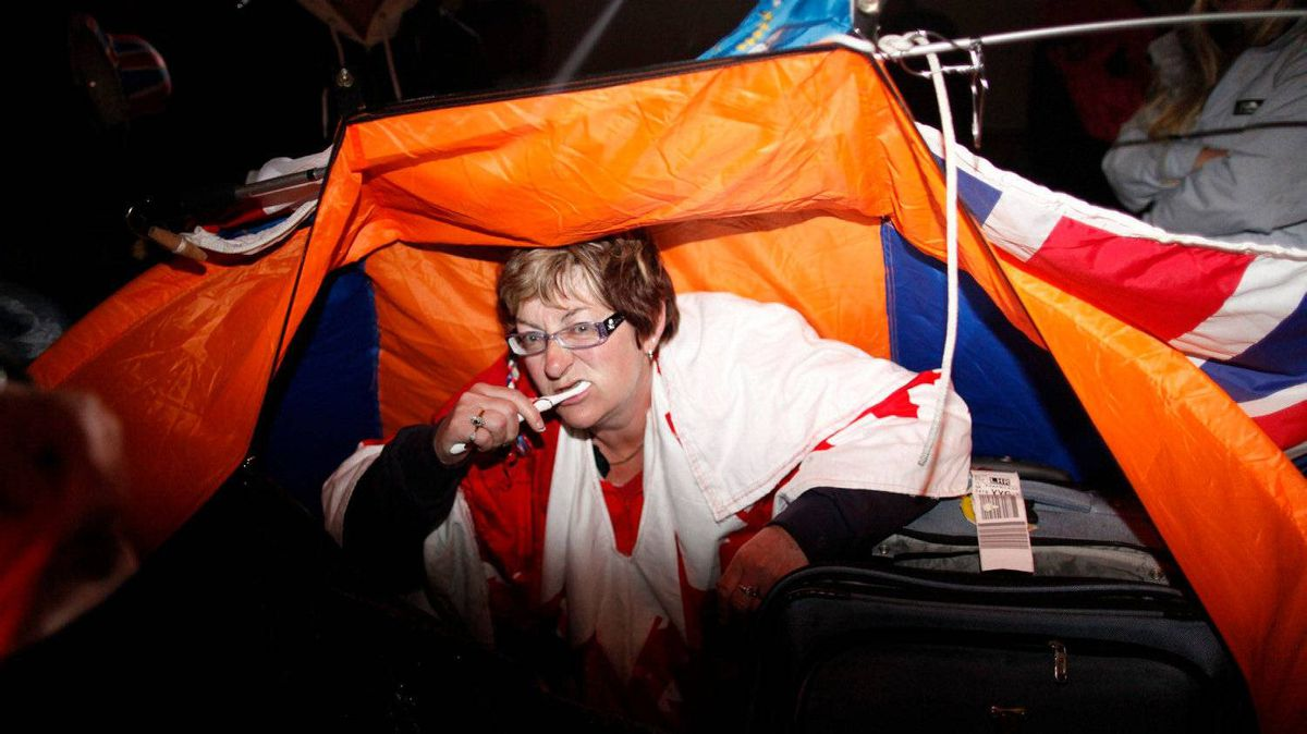 Bernadette Christie from Alberta, Canada, brushes her teeth as she wakes up in a tent after camping along the Royal Wedding route in London Friday, April, 29, 2011.