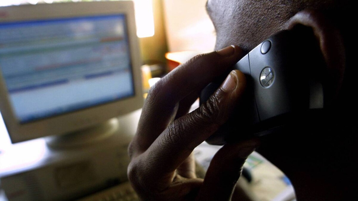 A teller at a customized mobile telephone service provider transacts through on the Internet in Nairobi in this 2006 file photo.