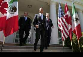 U.S. President Barack Obama, (C), Canada's Prime Minister Stephen Harper (R), and Mexico's President Felipe Calderon (L) walk out of the Oval Office before a joint press conference in the Rose Garden of the White House in Washington.