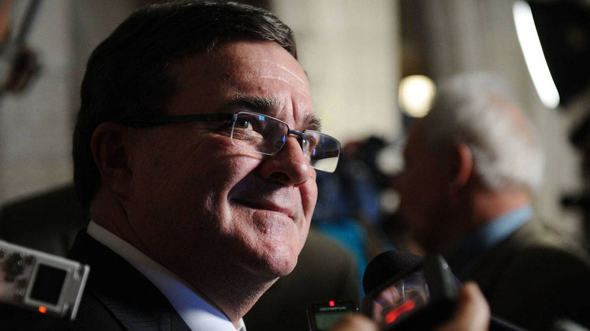 Finance Minister Jim Flaherty speaks to reporters in the foyer following Question Period in the House of Commons on Parliament Hill in Ottawa on Tuesday, June 14, 2011.