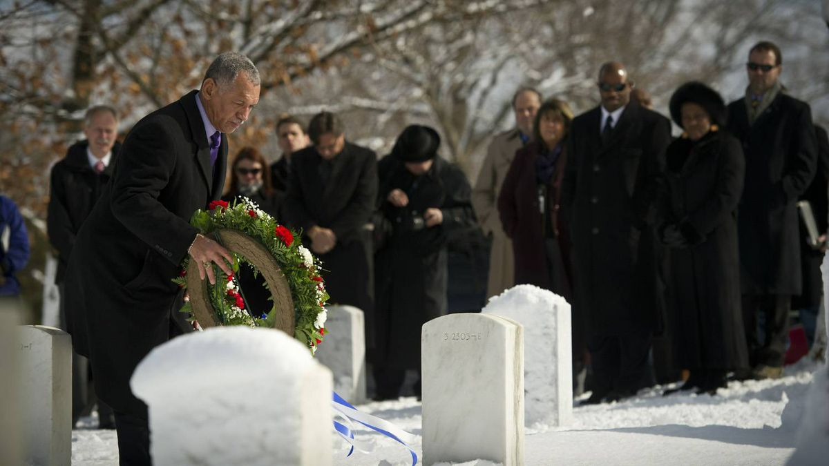 NASA Administrator Charles Bolden lays a wreath as other NASA personnel watch during ceremony as part of NASA's Day of Remembrance at Arlington National Cemetery Jan. 27, 2011 in Arlington, Va.