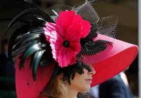 Melinda Horn watches one of the races before the 137th running of the Kentucky Oaks horse race at Churchill Downs Friday, May 6, 2011, in Louisville, Ky.