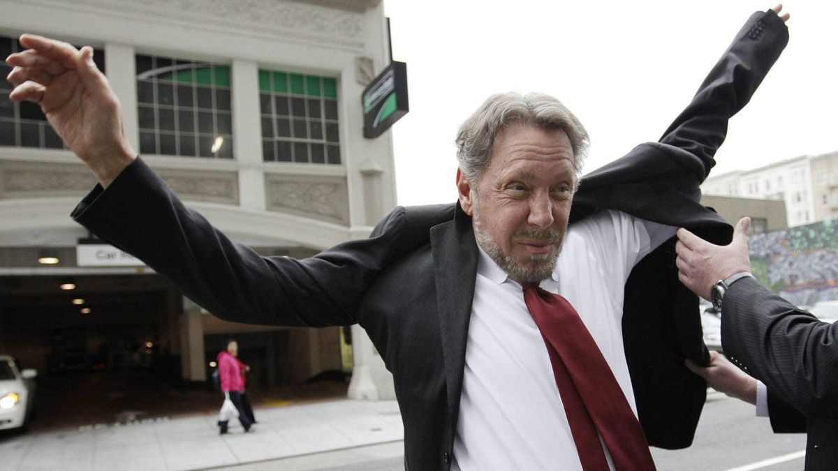 Oracle CEO Larry Ellison, left, puts on his suit as arrives for a court appearance at a federal building in San Francisco, Tuesday, April 17, 2012.