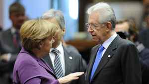 German Chancellor Angela Merkel (L) speaks with Italy Prime Minister Mario Monti before the start of a working session during an European Union summit at the EU headquarters on December 9, 2011 in Brussels.