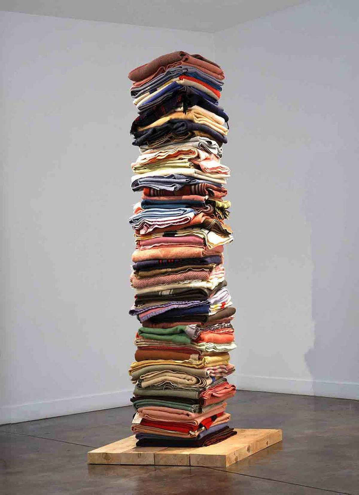 Marie Watt, Blanket Stories: Seven Generations, Adawe, and Hearth (detail), 2013. Folded and stacked blankets, paper tags, Site