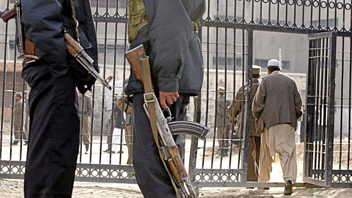 In this file photo dated Friday, Dec. 17, 2004, Afghan security police officers stand guard in front of the Pul-e Charkhi prison's gate in Kabul, Afghanistan.