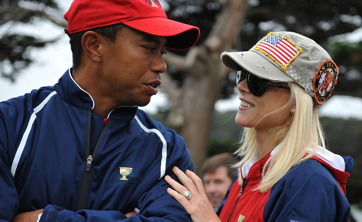 U.S. team member Tiger Woods and his wife Elin Nordegren talk on the golf course at the Presidents Cup golf competition in this October 11, 2009 photo at Harding Park Golf course in San Francisco, California.
