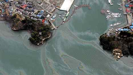 This aerial view taken on March 14, 2011 during an AFP-chartered flight shows traces of petrol floating on the surface of water in an area hit by the tsunami outside Sendai, in Miyagi prefecture three days after a massive 8.9 magnitude earthquake and tsunami devastated the coast of eastern Japan. Japan's government on March 15 urged people against panic-buying of food and supplies, as the country grapples with an earthquake and tsunami and resulting nuclear crisis. AFP PHOTO / NOBORU HASHIMOTO (Photo credit should read NOBORU HASHIMOTO/AFP/Getty Images)