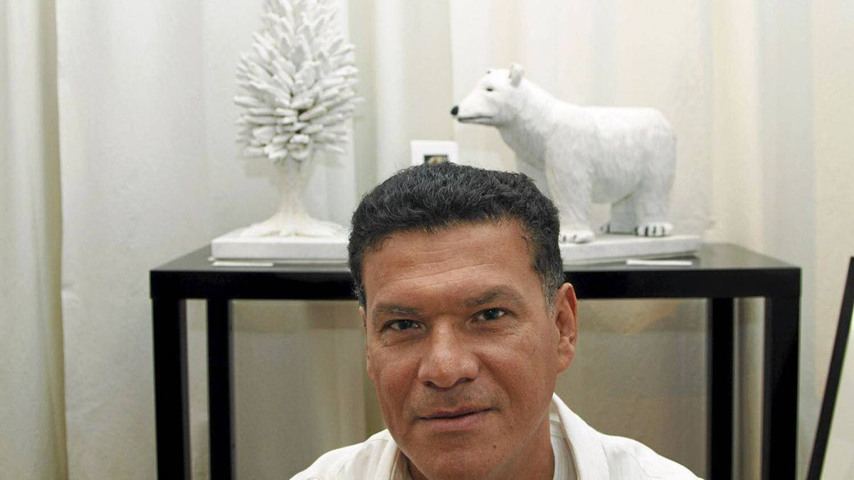 Sculptor Francisco Castro Lostalo with his sculptures made of Carrara marble recycled from the renovation of the First Canadian Place building in downtown Toronto, December 27, 2010.