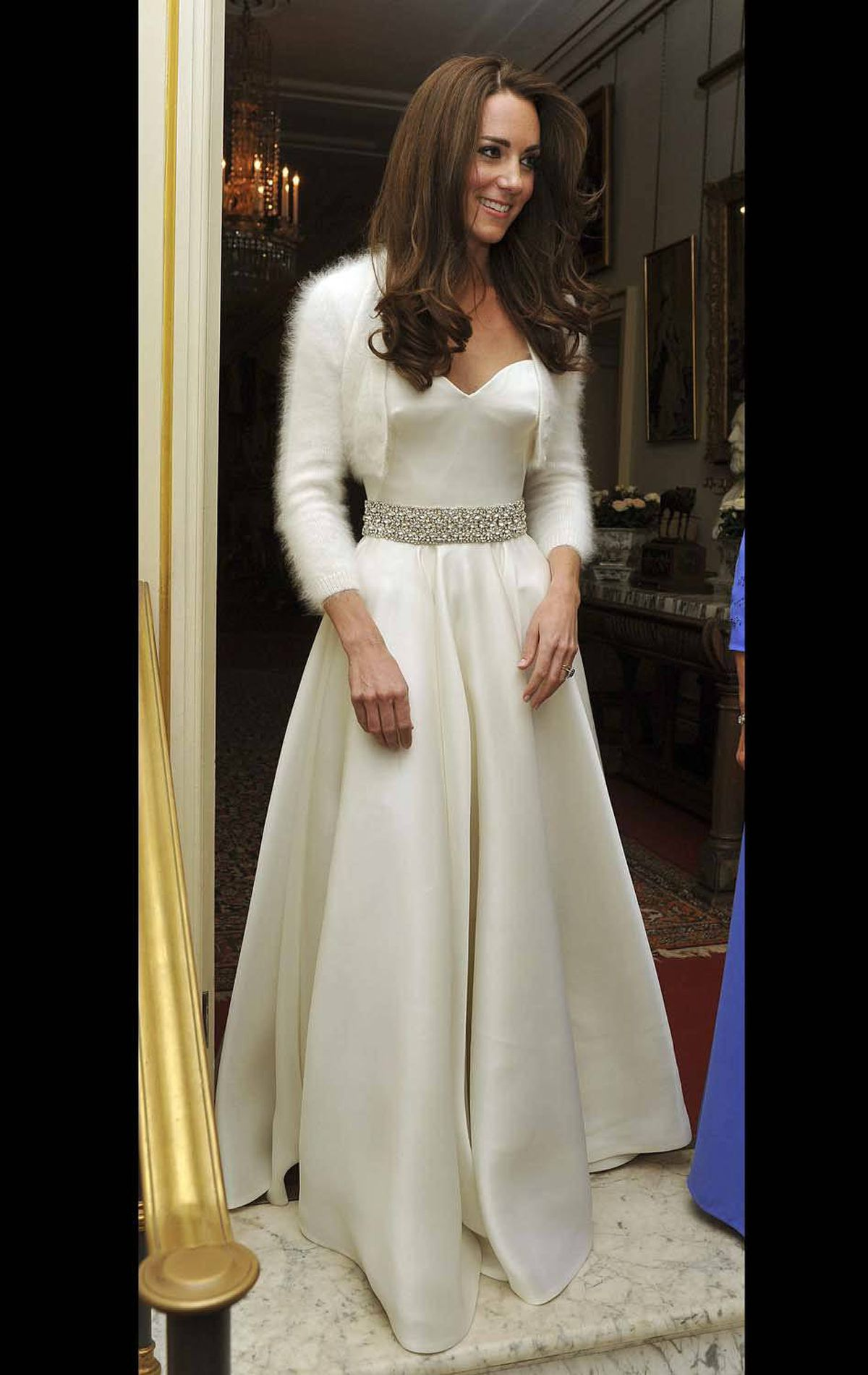 After the ceremony, she changes into another Alexander McQueen satin gown and a white angora bolero for evening celebrations at Buckingham Palace.
