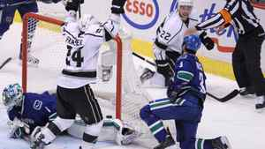 Los Angeles Kings center Colin Fraser celebrates Kings center Trevor Lewis's goal past Vancouver Canucks goalie Roberto Luongo as Canucks defenseman Kevin Bieksa looks on during third period of game two of first round NHL Stanley Cup playoff hockey action at Rogers Arena in Vancouver, B.C. Friday, April, 13, 2012.
