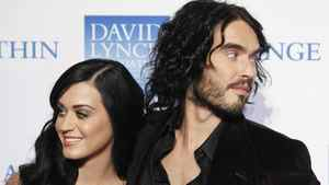 Singer Katy Perry arrives with her husband, actor Russell Brand, for the annual David Lynch Foundation benefit celebration in New York in this December 13, 2010.