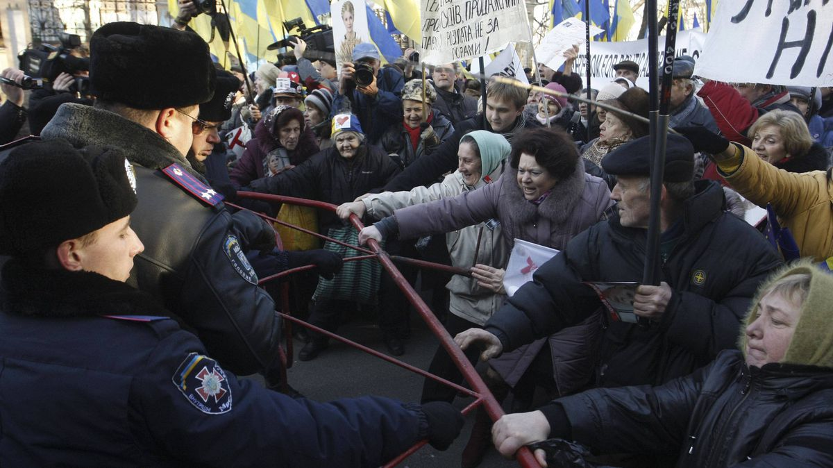 Supporters of former opposition leader Yulia Tymoshenko confront the police at a protest in Kiev on Monday.