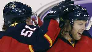 Florida Panthers' Brian Campbell (51) celebrates with Kris Versteeg (32) after Versteeg scored the first goal of the game during the second period of Game 5 in a first-round NHL Stanley Cup playoff hockey series in Sunrise, Fla., Saturday, April 21, 2012, against the New Jersey Devils. The Panthers won Game 5 3-0 to take a 3-2 series lead. (AP Photo/J Pat Carter)