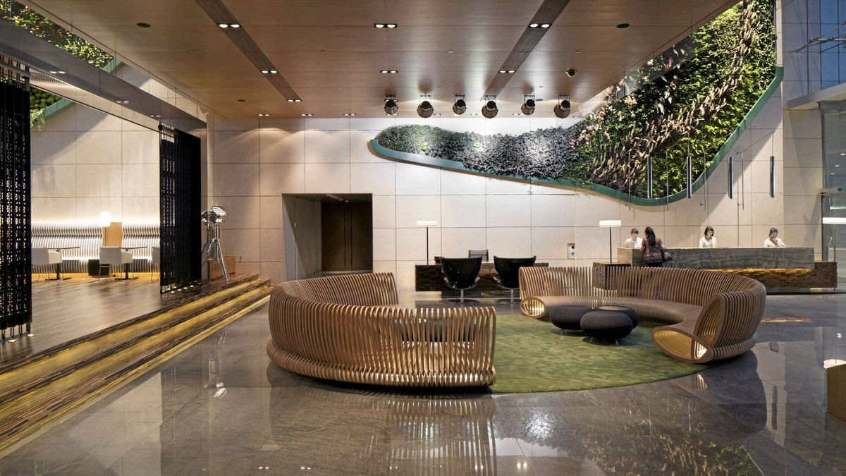 A lush vertical garden greets guests in the lobby at Hotel Icon.
