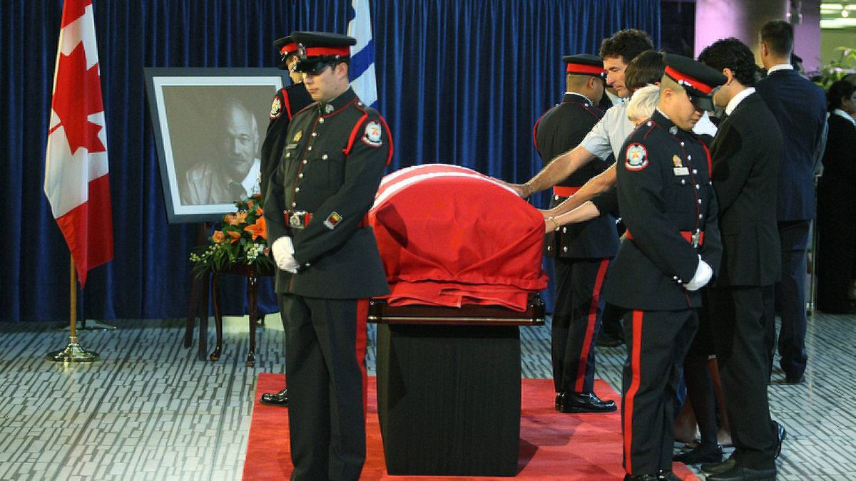 Mourners pay their respects at the casket of Mr. Layton at City Hall in Toronto.