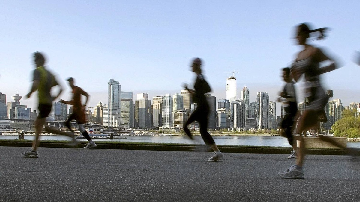 Competitors in the 37th annual Vancouver Marathon run through Stanley Park in 2008.