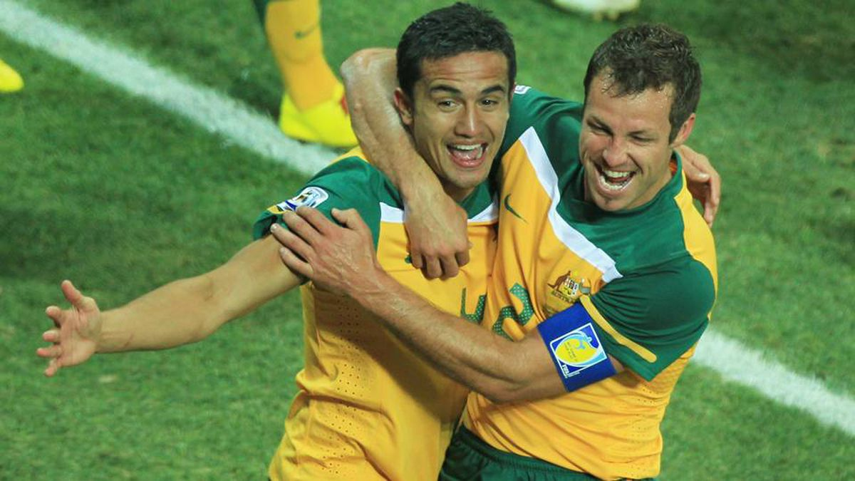 Tim Cahill of Australia celebrates scoring the opening goal with team mate  Lucas Neill during the bf76a81247b33
