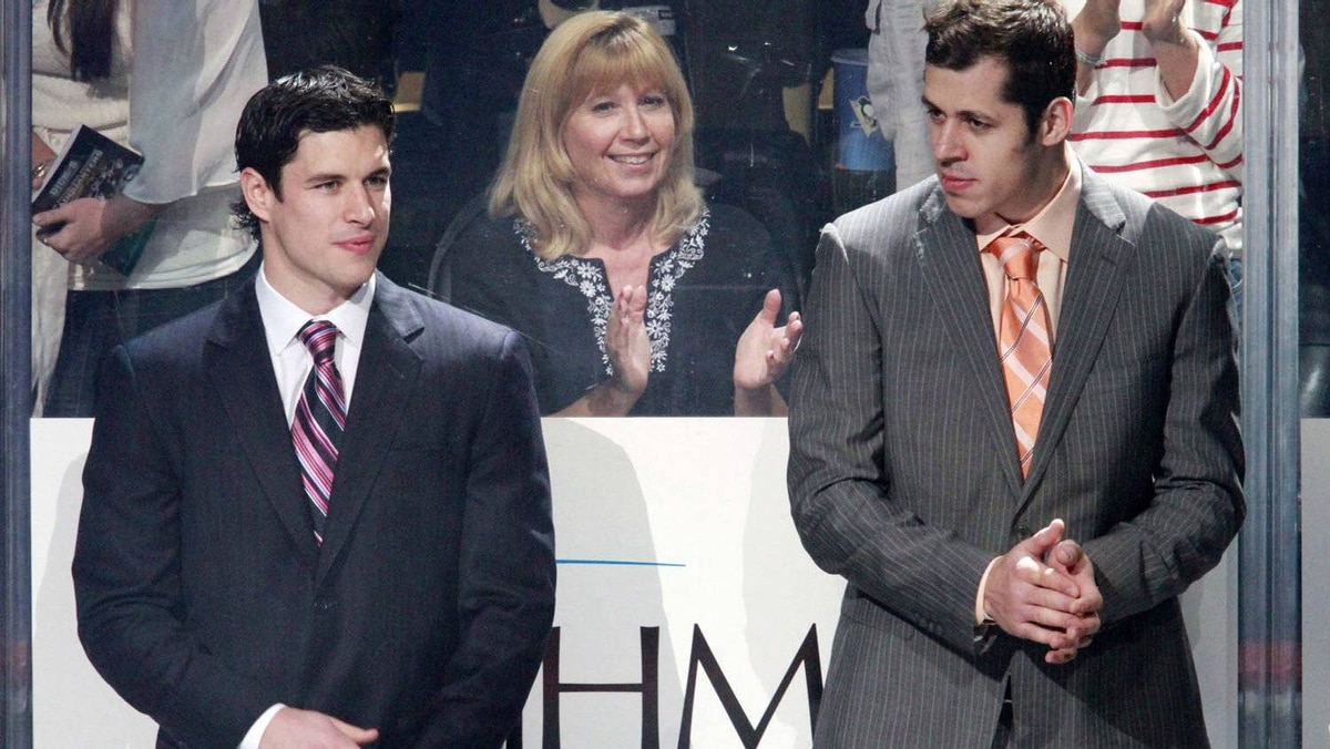 Pittsburgh Penguins' Sidney Crosby, left, and Evgeni Malkin of Russia, are introduced before the the Penguins first home NHL hockey game of the season against the Florida Panthers in Pittsburgh Tuesday, Oct. 11, 2011. Crosby and Malkin did not play in the game. (AP Photo/Gene J. Puskar)