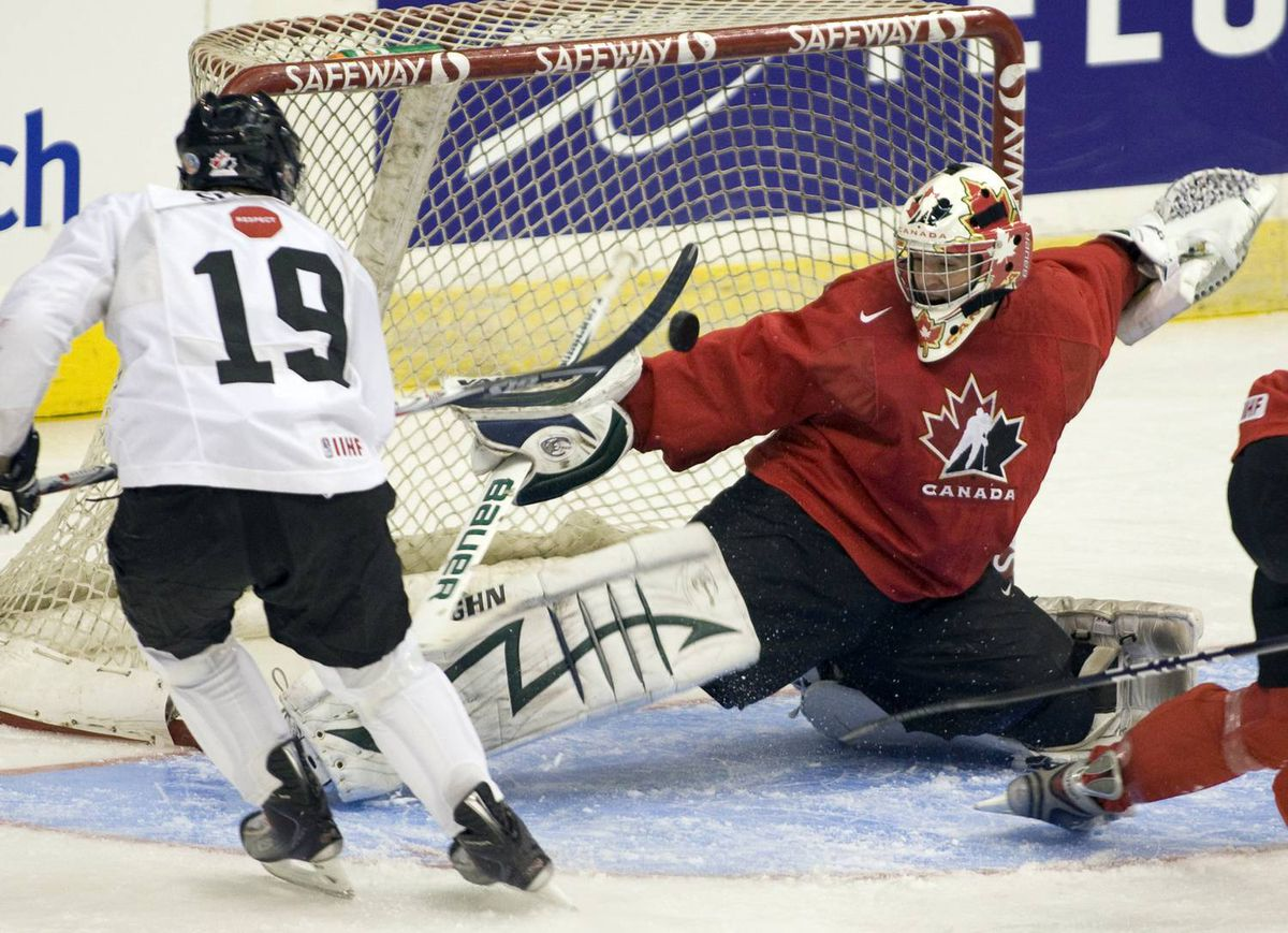 Canadian national junior team goaltender Matt Hackett stops Plymouth Whalers teammate Tyler Seguin during an intra-squad game Sunday, December 13, 2009 as the team opens its selection camp for the World Junior Championships in Regina. THE CANADIAN PRESS/Ryan Remiorz
