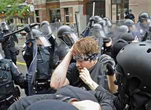 Anti-G20-summit protesters clash with police in downtown Toronto on 25, 2010.