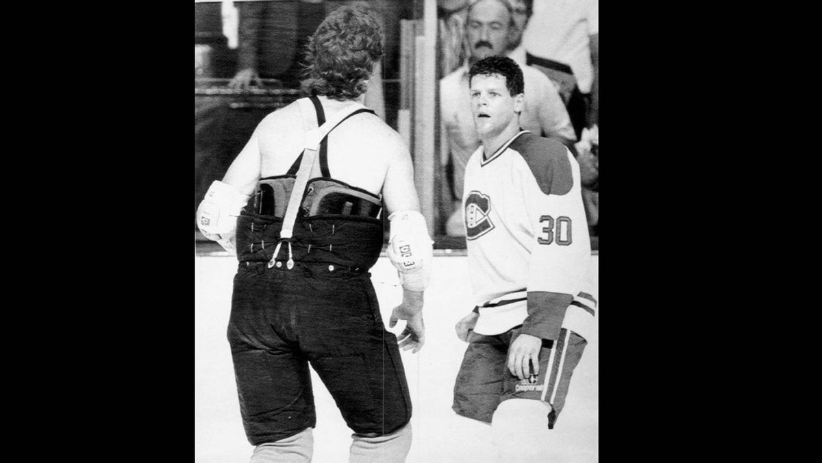 Philadelphia Flyers Dave Brown, sans jersey, goes after Montreal Canadiens Chris Nilan, right, during a pregame brawl precipitated when a Canadiens player shot the puck into the Flyers net during the pregame warmup.