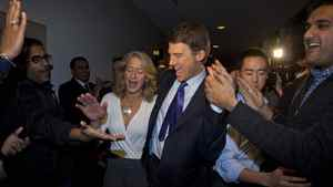 Mayor Gregor Robertson (right) and his wife Amy thank his supporters in Vancouver November 19, 2011.