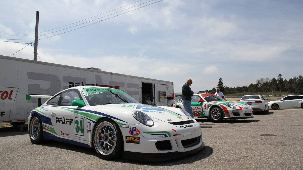 Porsche GT3 Cup cars line up before a practice lapping session at Mosport raceway.