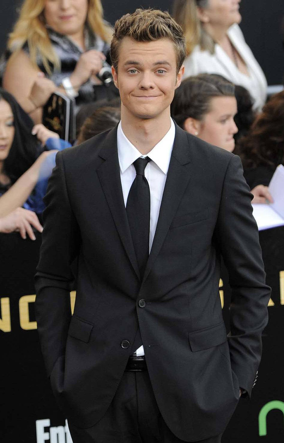 """Don't be sorry,"" Jack Quaid says at the world premiere of ""The Hunger Games"" in Los Angeles on Monday."