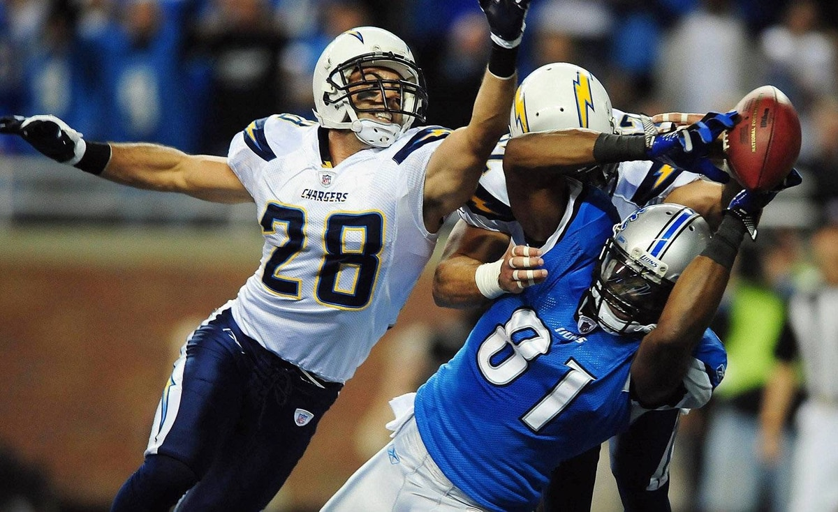 Detroit Lions wide receiver Calvin Johnson is unable to hold onto a pass while being defended by San Diego Chargers strong safety Steve Gregory during the first quarter at Ford Field. The Lions won 38-10 to clinch their first playoff berth since 1999.