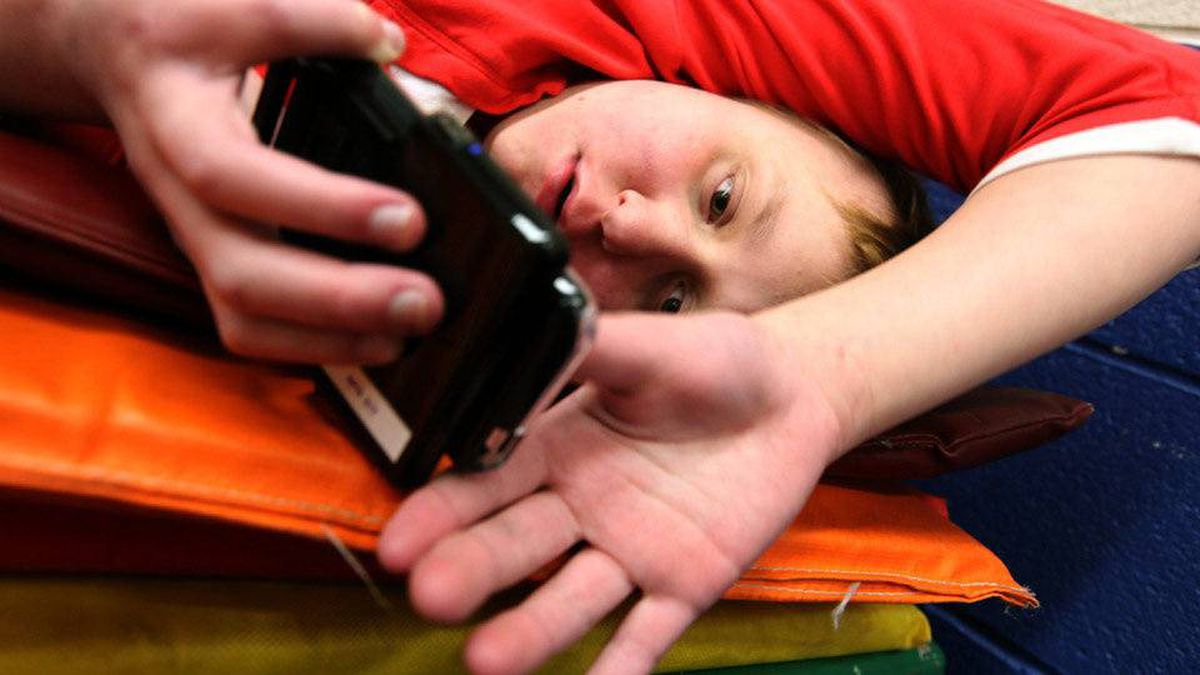 Autistic student Emily Buzcek, 13, has already mastered the iPod Touch, which helps her learn and communicate. The iPad's larger screen will be a big improvment, parents say.