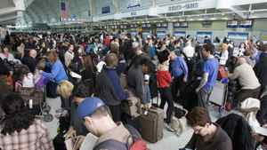 Thousands of passengers bound for the United States wait in line-ups due to security delays at Pearson Airport in Toronto on Sunday December 27, 2009. More than 108,000 passengers are expected to travel through the airport on March 9, 2012.