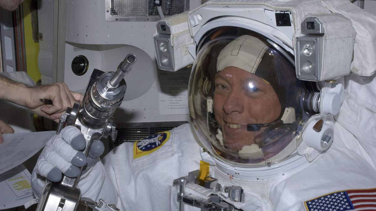 NASA astronaut Mike Fossum checks out his pistol grip tool in the International Space Station's Quest airlock prior to his July 12 spacewalk in this photo provided by NASA and taken July 12, 2011.
