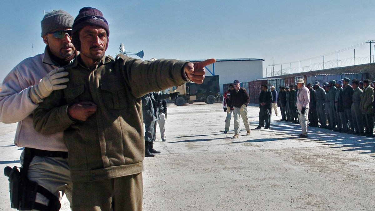 Afghan men are trained by U.S. military contractors during an exercise in the southern town of Qalat in January 2007.
