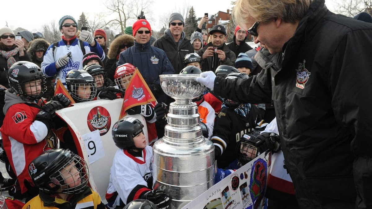 The keeper of the Stanley Cup places it in a sleigh to be skated by youngsters down the Rideau Canal Skateway during the opening ceremonies to the All-Star weekend in Ottawa on Thursday, January 26, 2012.