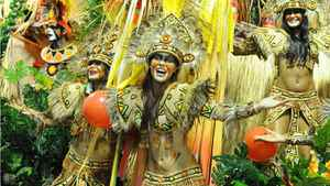Revelers of the Academicos do Grande Rio samba school performs atop a float at the Sambadrome.