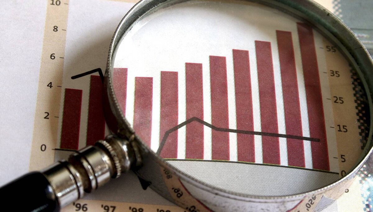 File #: 1257465 Business Focus. A magnifying glass focusing on a chart in the business section of the newspaper. Credit: Tan Wei Ming / iStockphoto (Royalty-Free) Keywords: Growth, Magnifying Glass, Finance, Chart, Charity and Relief Work, Business, Sale, Questionnaire